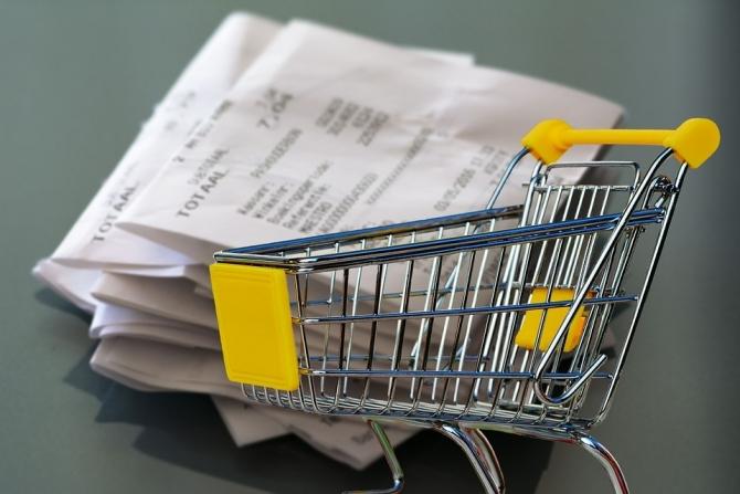 Imagen de un carrito de la compra y un ticket de compra.